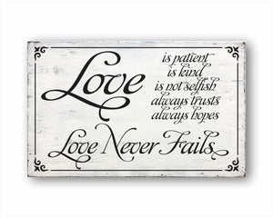 love is patient love is kind love is not selfish love always trusts love always hopes love never fails box sign