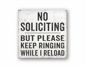 No Soliciting But Please Keep Ringing While I Reload Sign