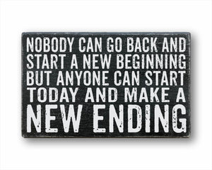 Nobody can go back and start a new beginning but anyone can start today and make a new ending rustic wood sign
