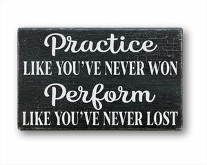 Practice Like You've Never Won Perform Like You've Never Lost Sign