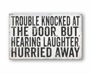 Trouble Knocked At The Door, But, Hearing Laughter, Hurried Away Box Sign
