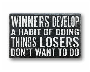 Winners Develop A Habit Of Doing Things Losers Don't Want To Do Sign