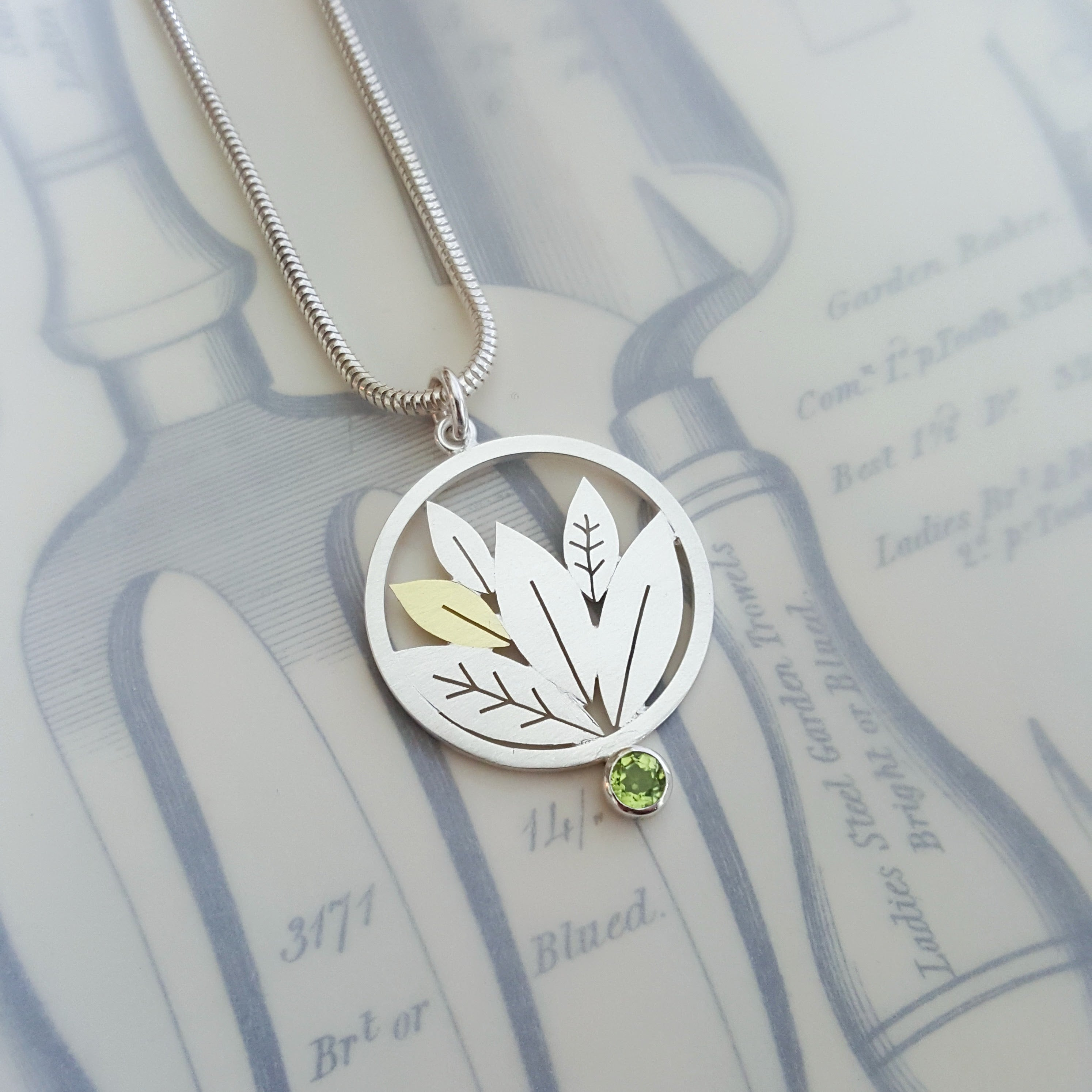 leafy pendant with a peridot by diana greenwood