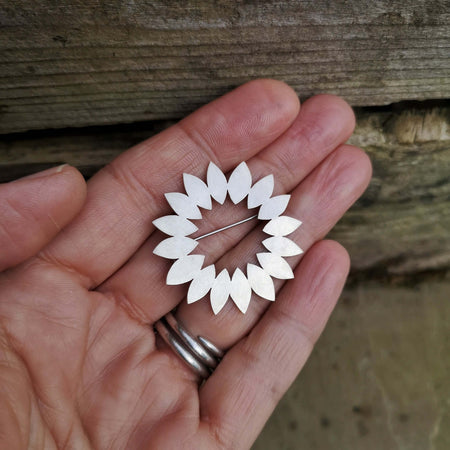 circle of petals brooch by diana greenwood