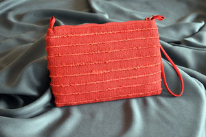 Red clutch with silk cord