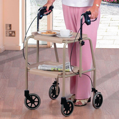 Woman walks with wheeled dining trolley walker