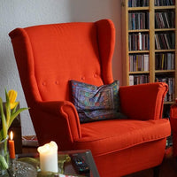 Red highback chair in living room