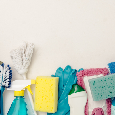 An array of multi-coloured cleaning brushes and sponges