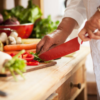Chef chopping vegetables on chopping board