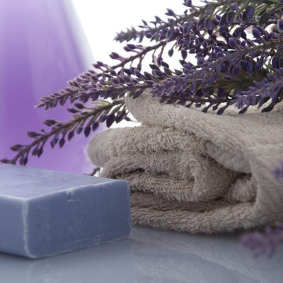 Folded towel pad next to soap with lavender