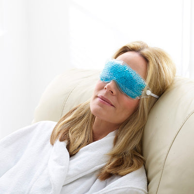 Blonde woman wearing Therapearl cooling eye mask