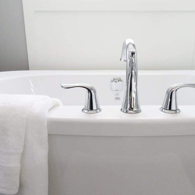 Close up of bathtub and chrome taps