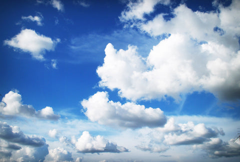 the image shows a blue sky with some clouds