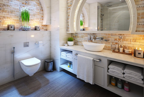the image shows a very nice looking bathroom with an arched mirror.