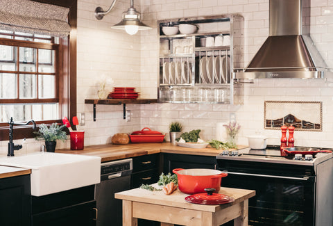 the image shows a picture of a nice country kitchen