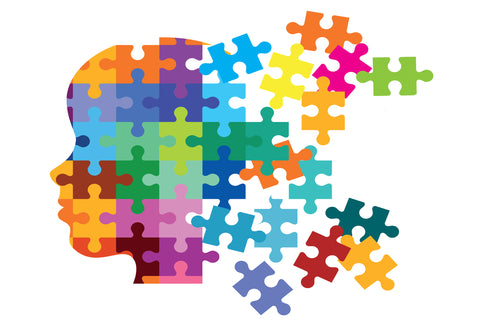 the image shows a picture of a head which is made up of many multi-colour jigsaw pieces. Some of the jigsaw pieces are breaking away from the head