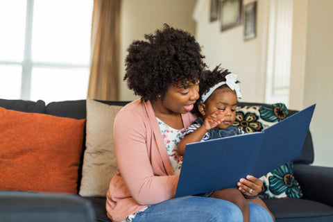 the image shows a mother and child reading a book