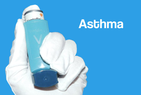 A white gloved hand holding an inhaler – the word – asthma – can also be seen