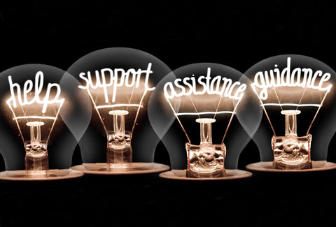 Four lightbulbs with the filaments changed to words – help, support, advice and guidance