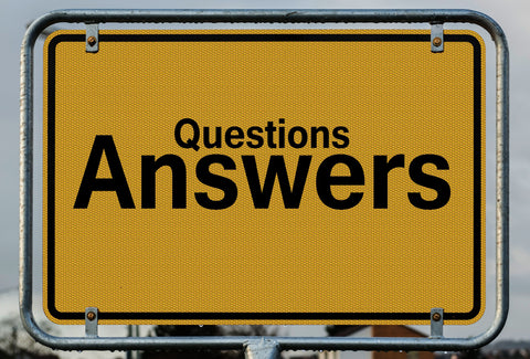 A sign with the words – questions answers – on it