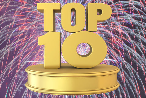 Bright and colourful fireworks can be seen in the background. The – Top 10 – logo is on top of the fireworks
