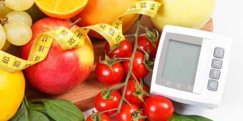 the image shows a blood pressure test with some healthy food and a tape measure