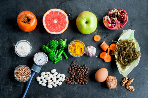 the image shows a selection of healthy food with a blood pressure monitor