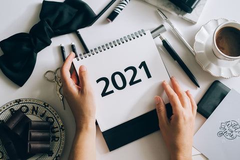 the image shows someone holding a 2021 calendar
