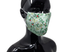 the image shows the christmas mistletoe face mask