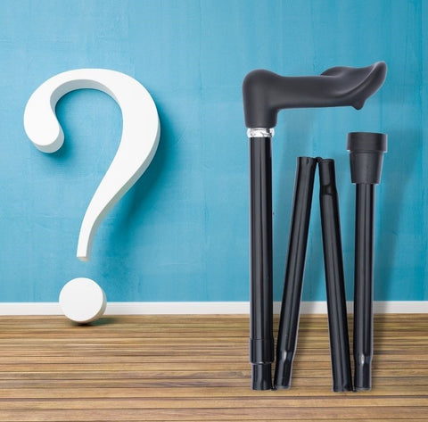 the image shows a big question mark next to a walking stick with a ferrule on it.
