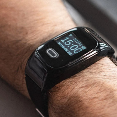 A close up of the out-and-about personal alarm watch on a man's wrist