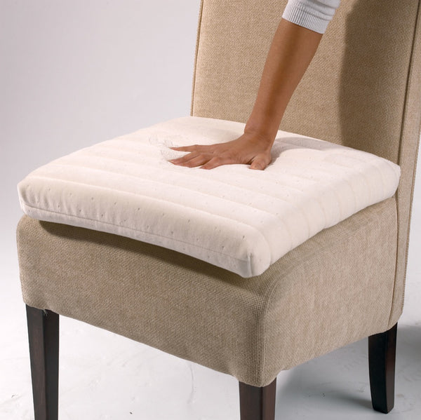 the image shows the memory foam seat cushion on a chair with a hand placed on the cushion