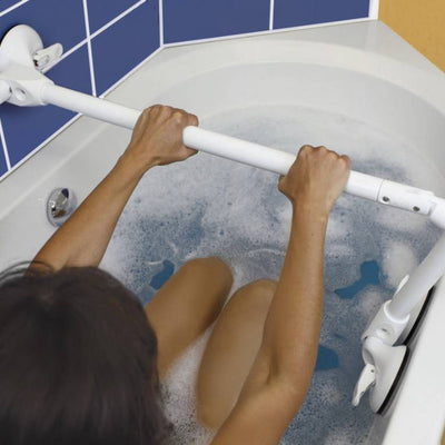 image shows woman in bathtub holding the Mobeli Quatro Power Tub rail