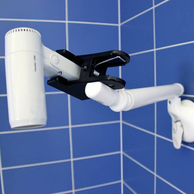 image shows a cordless hairdryer being held in place by the Mobeli Two Finger Holder