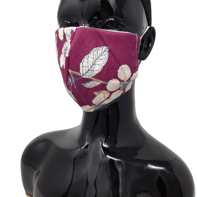 the image shows the washable reusable face mask in purple with flowers design