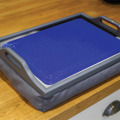 the image shows a blue anti slip silicone mat on a tray, on a table