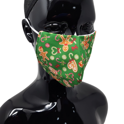 the image shows the gingerbread man and candy cane design christmas face mask