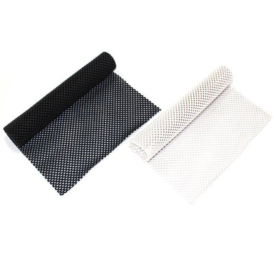 the image shows a black and a white non-slip mat