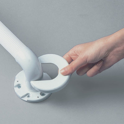 image shows a person's hand fixing a spare covering disc onto a grab rail