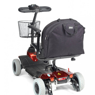 The image shows the large backpack scooter bag fixed to the back of a mobility scooter
