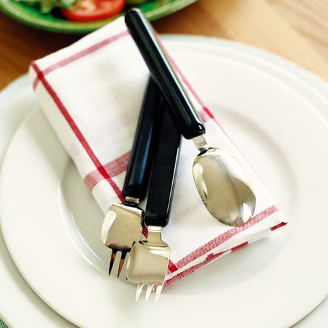 the image shows the Etac Light Combination Cutlery resting on a napkin on a plate