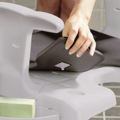 the image shows the etac swift seat cushion being attached to an etac swift