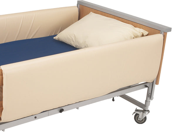 the image shows a pair of cot side bumpers on a wheeled bed