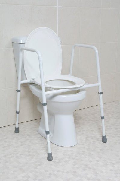 the image shows the height adjustable toilet frame with seat on a toilet