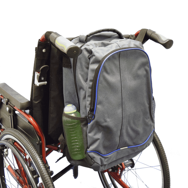 The image shows the Mobility Rucksack with Pockets attached to the back of a wheelchair.