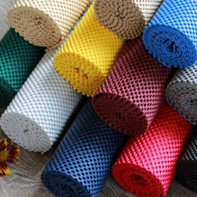 the image shows the eleven different colours of non-slip fabric rolls