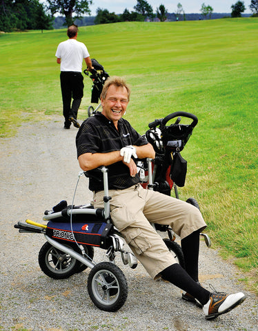 photo of a happy golfer resting on his Trionic Veloped Golf Medium at a golf course