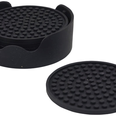 the imagfe shows the non-slip silicone table coaster stacked in the holder with one out on a table