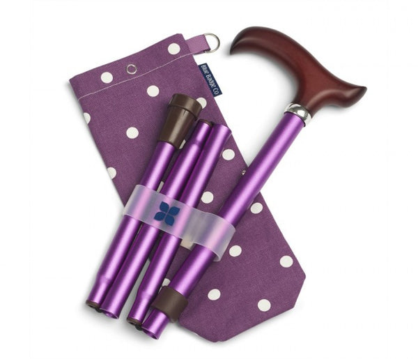 The image shows the purple walking stick with spotty bag