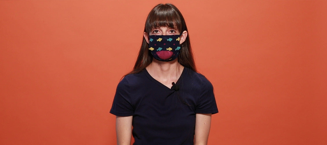 Woman wearing sock face mask